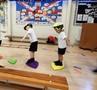 Learning balance skills on different sized 'rocks.'