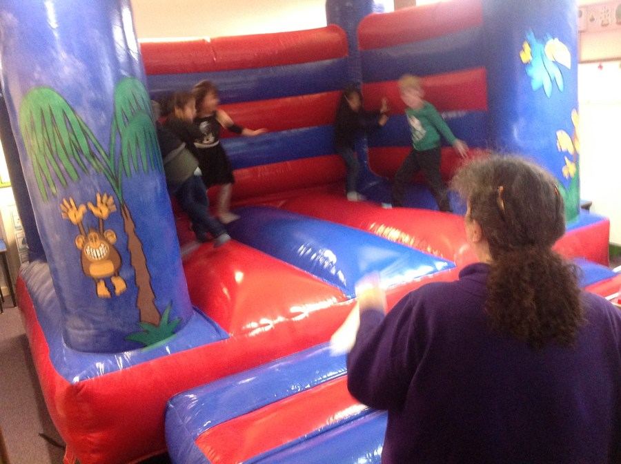 Shark class enjoying the bouncy castle for highest attendance this half term