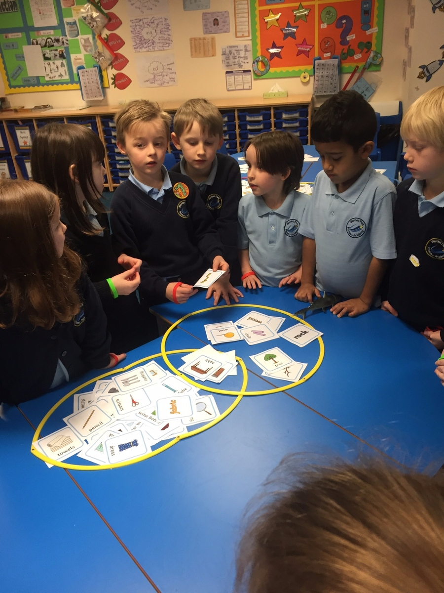 Here is Luca being a great teacher. He is explaining how his team grouped the materials. They decided to use their maths knowledge and created a Venn Diagram.