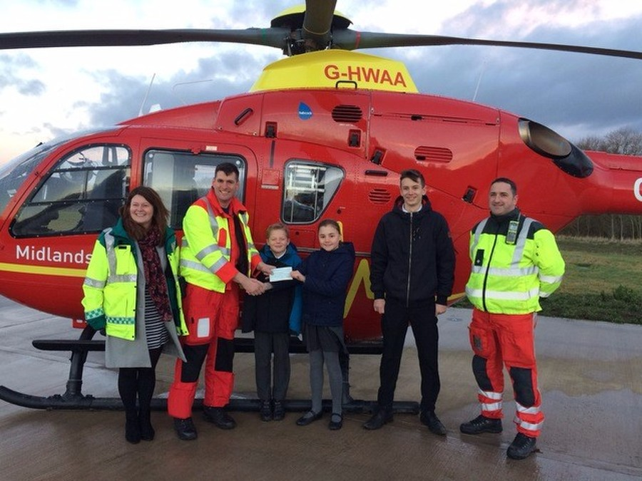 2016/17: Georgina and Will presenting a cheque to Midlands Air Ambulance.