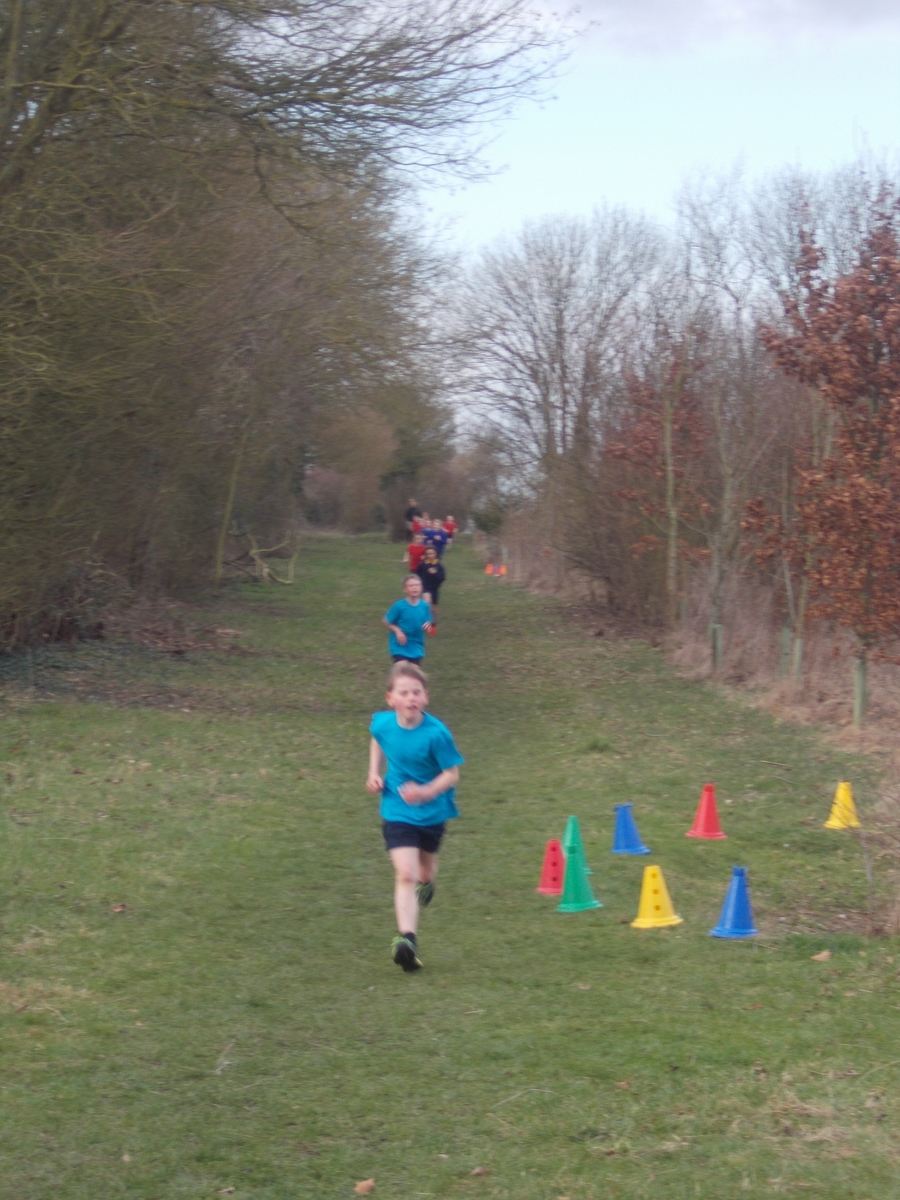 Luke and Oskar leading the boys race