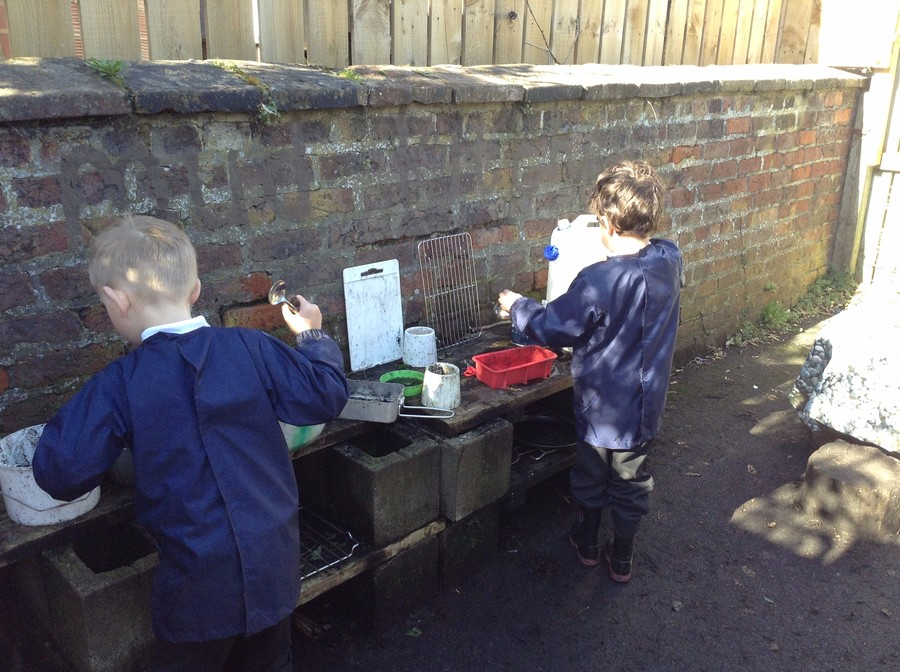 Cooking in the mud kitchen.