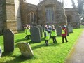 Adverbs - Carefully/slowly we rubbed the wax over the gravestones