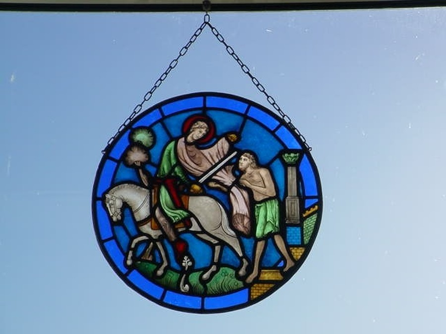 Whilst refurbishing the stained glass windows at St Martin's Church, a beautiful stained glass roundel depicting St Martin of Tours was made by Jonathan Leckie and donated to St Martin's Infant School. It hangs proudly in the small school hall