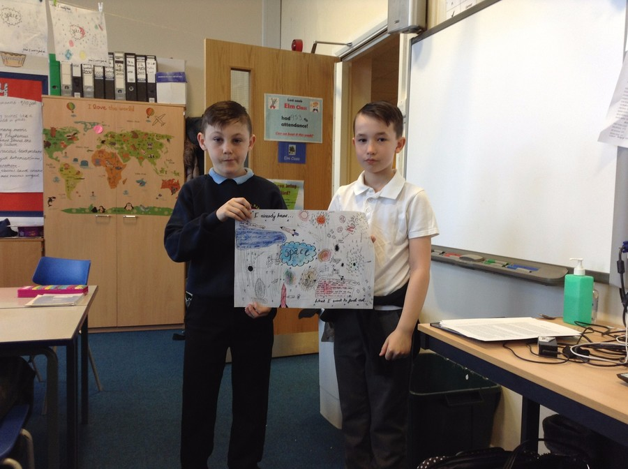 Two of our pupils from Elm Class working together on an Anti-Bullying Campaign poster