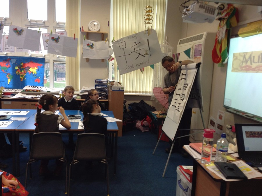 The children learning Chinese writing as part of our China themed week