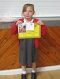Ella with her Stagecoach certificate and report which was full of praise for her great efforts in drama.<br>