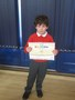 Jacob with his swimming certificate. Well done!