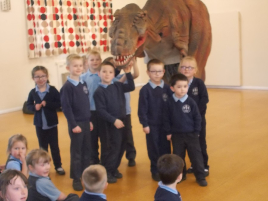 We couldn't believe it when a dinosuar came to our school!