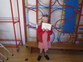 Well done Belleon receivingher Osprey Cheerleading certificate