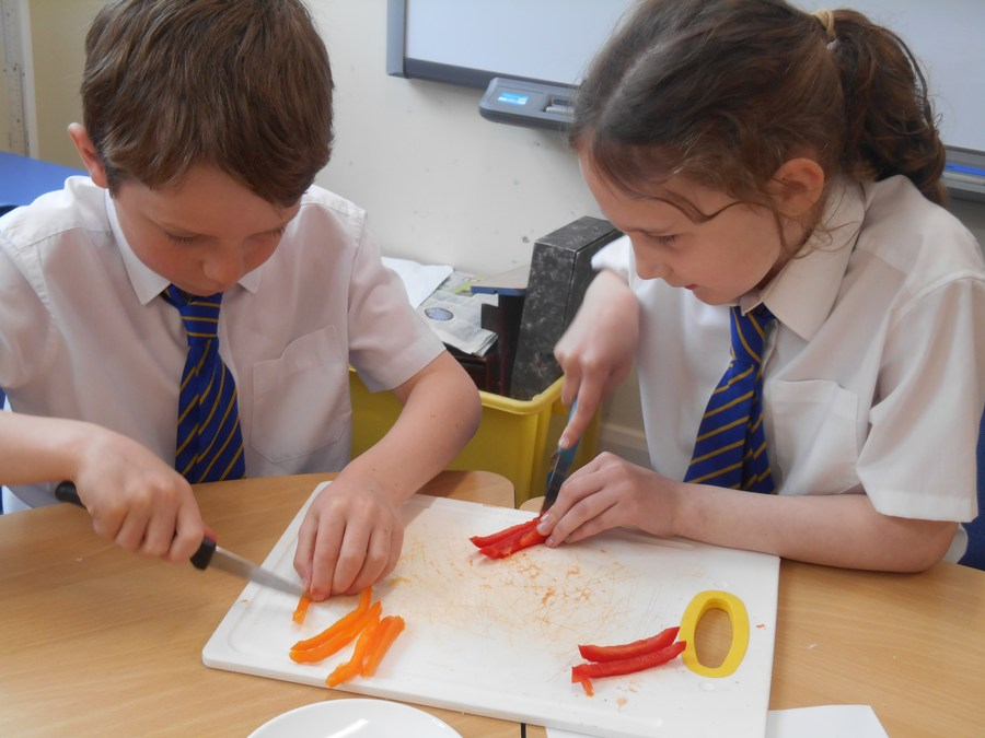 Preparing vegetables for our mini pizza quiches!