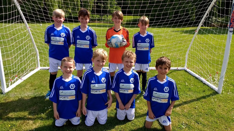 Year 3/4 team in our new kit sponsored by SportsBeat and Ramsac