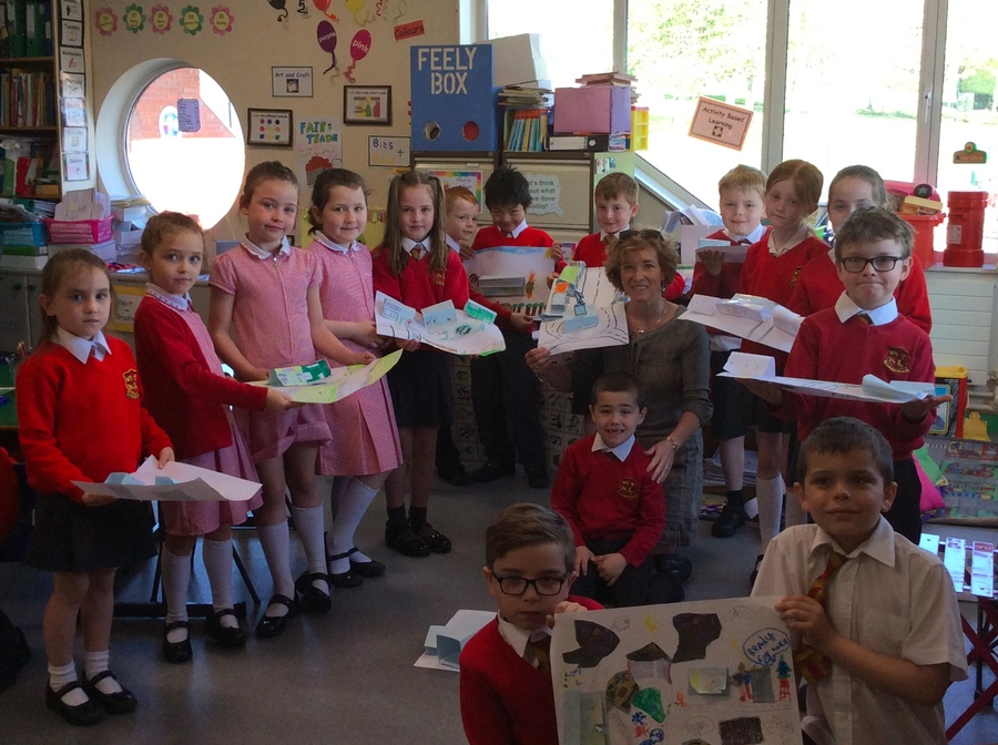 Some of P.3D pupils are pictured with the street scenes which they built.  Mrs Morrow was invited to look at their great work.