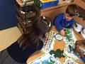 We played a beanstalk board game, learning about adding and taking away