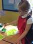Mixing paint to make green for leaves.JPG