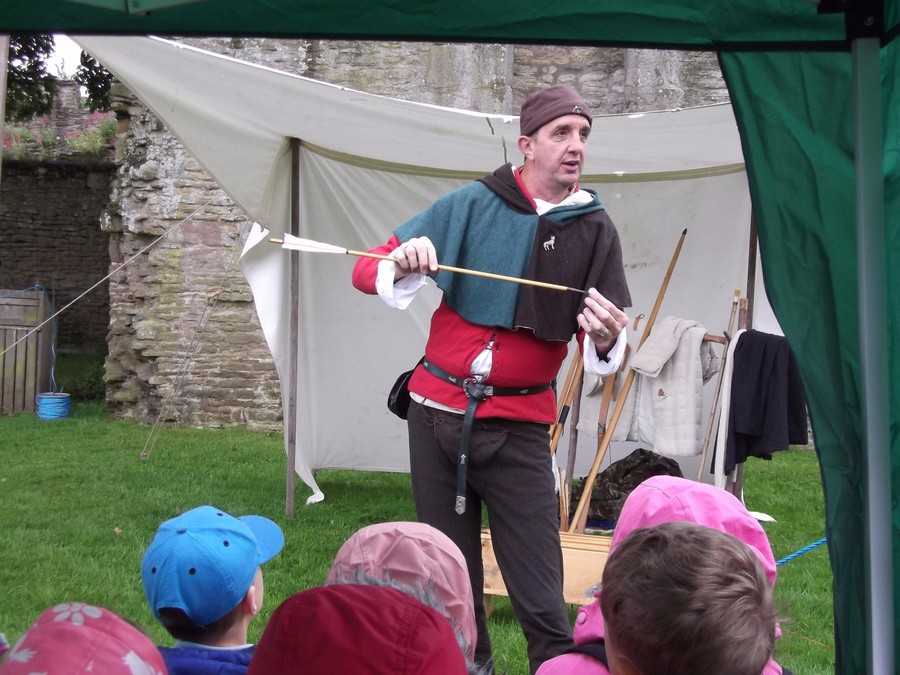 The archer showed us different arrows and bows for different jobs, like killing animals or for defending the castle.
