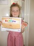 Lexi's swimming certificate.