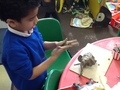 Using clay to make an elephant