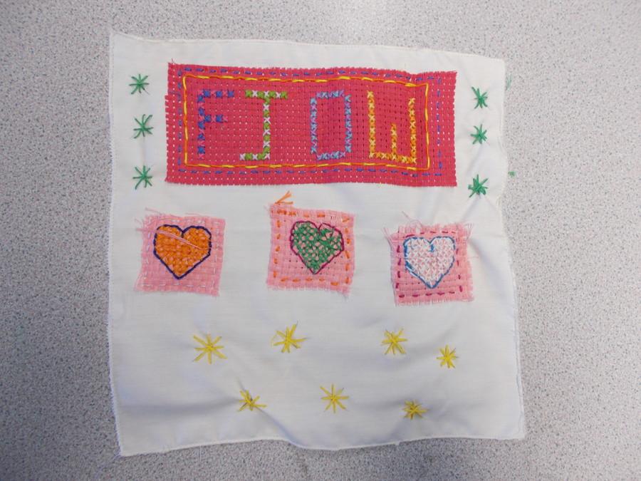 A beautiful embroidered napkin.
