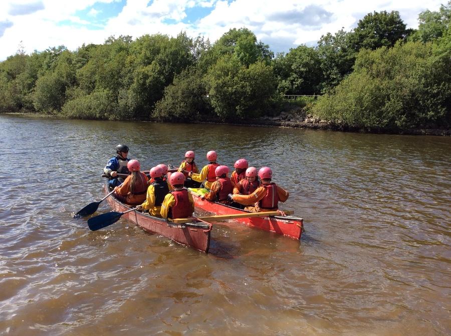 everyone in the canoe