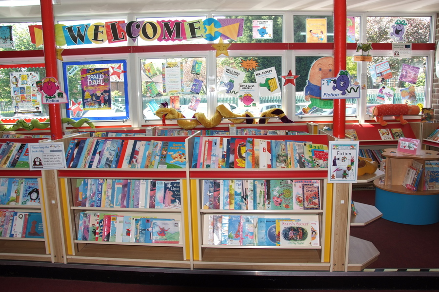 Lynpac Library. Children borrow books to take home to read. We have parents come into school to help run the Library.