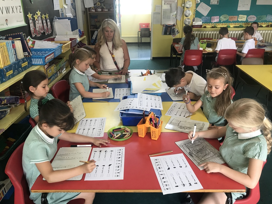 Children enjoying learning in a year 2 classroom.