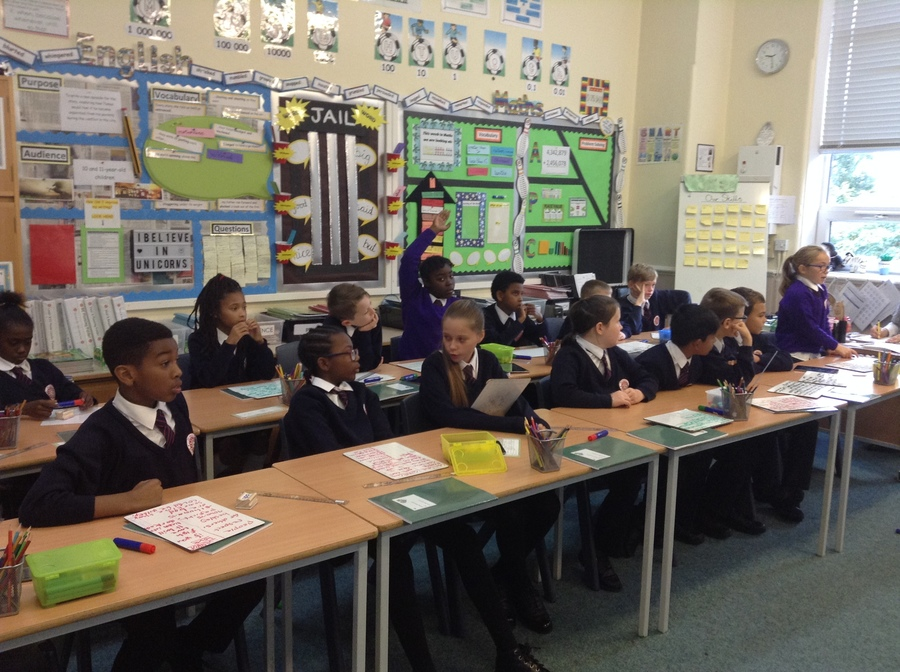 Year 6 debating whether humans can love unconditionally in RE lessons.