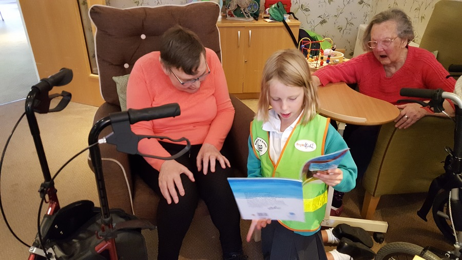 Reading stories to the residents