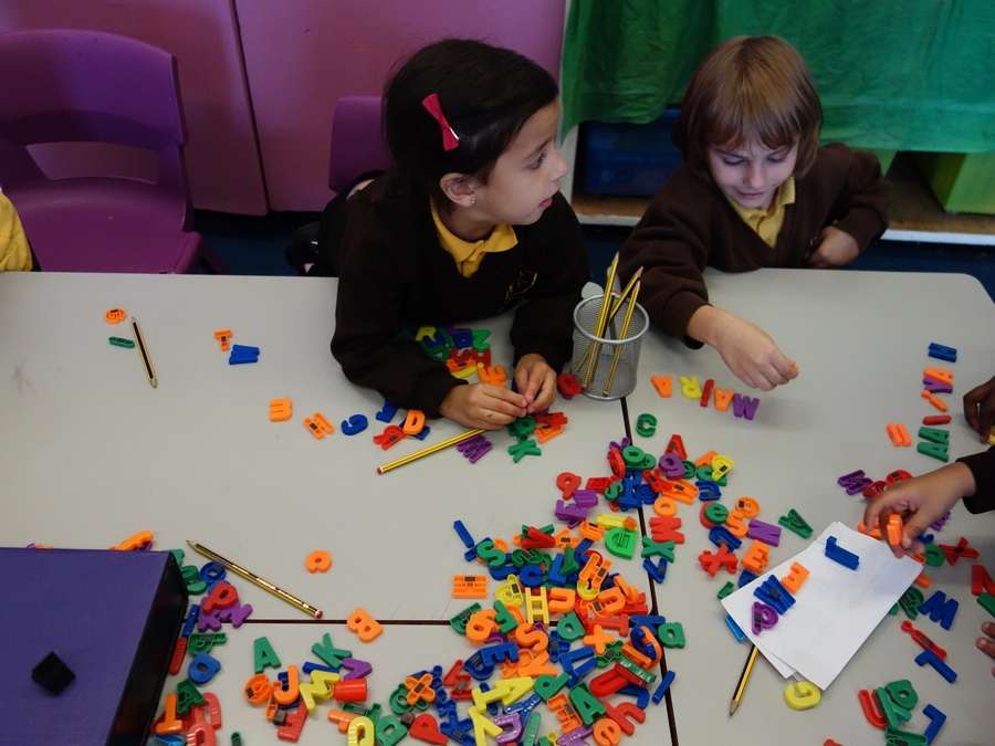 We are writing words with magnetic letters.