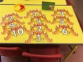Can you read the numeral<p>on the flames and add</p><p>the correct number of red pom</p><p>poms?</p>