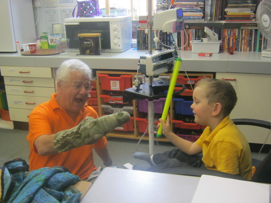 Get back naughty crocodile! George has a great time showing Mike, storyteller, who's boss!