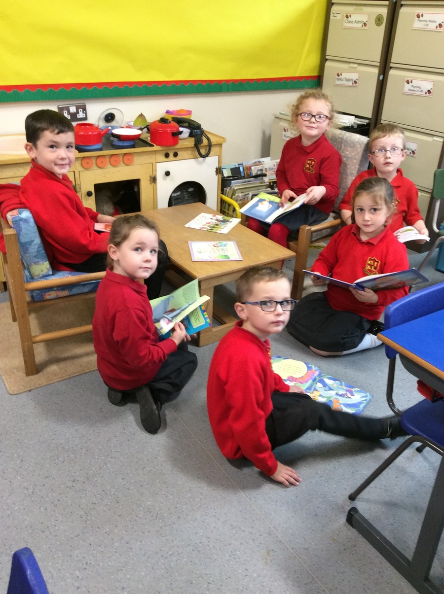 We love to look at books and enjoy reading in P.2R