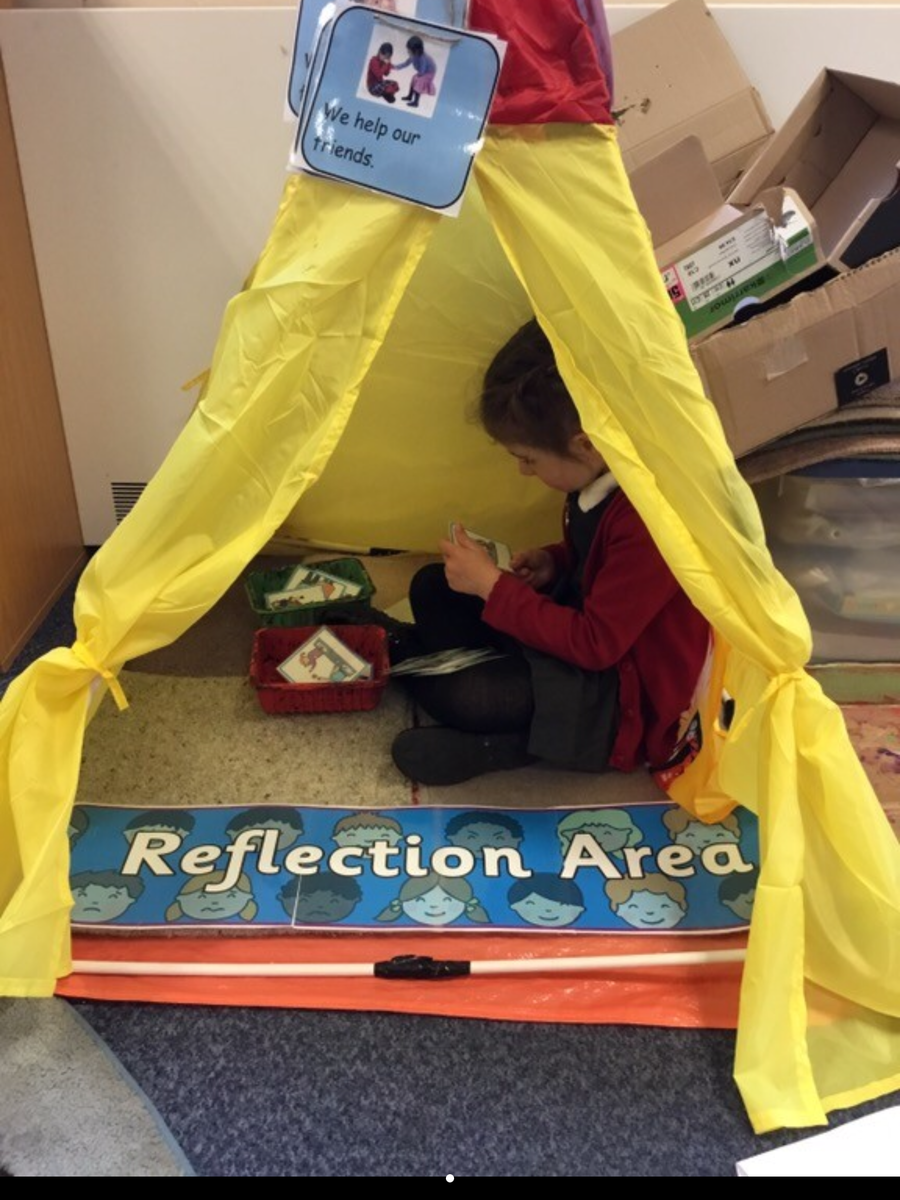 Looking at friendship behaviour cards in our reflection tent