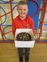 <p>Brogan won the McMillan Coffee</p><p>Morning 'Guess how many Smarties in the cake' competition<br></p>
