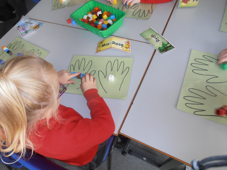 In P.2W we love to use cubes to count.