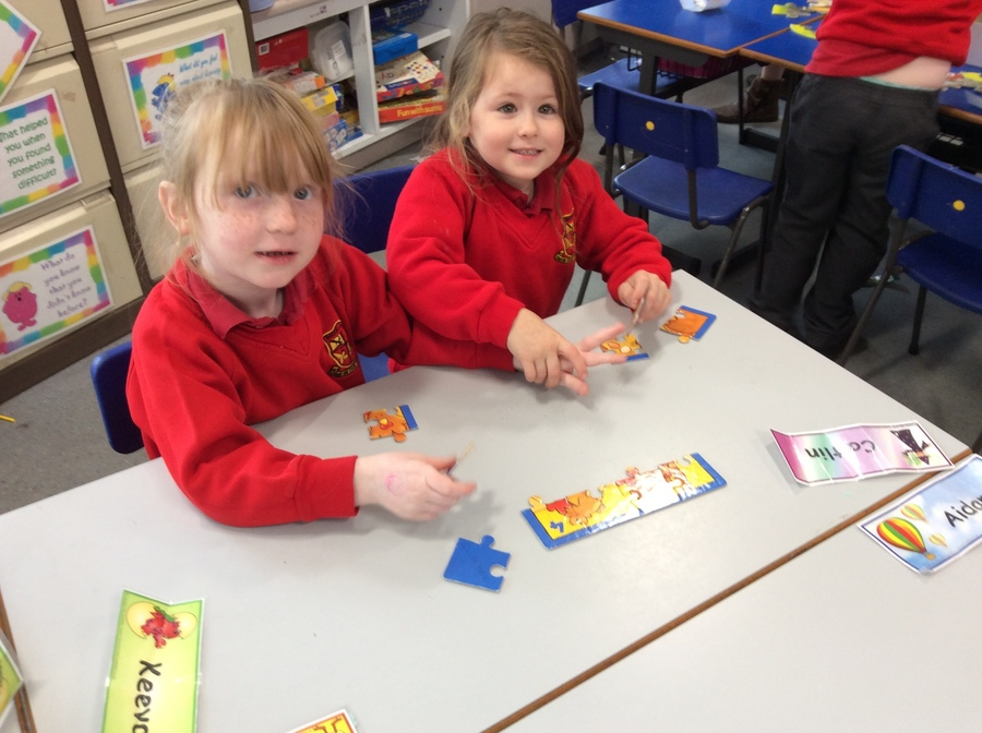 Casey and Amelia work together to complete their jigsaw.