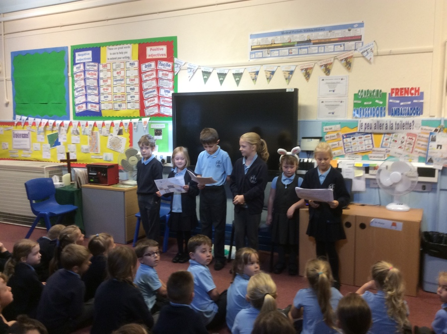 Worship group took an assembly on responsibility . They read Jonah and the Whale and told a story they had made up about caring for  pets.