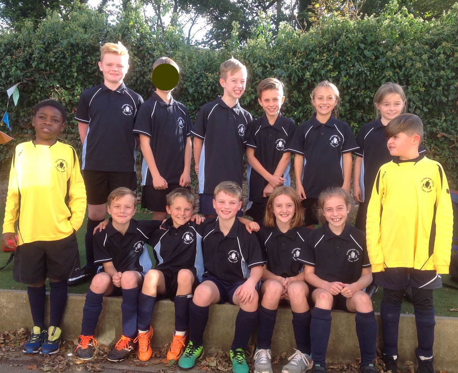 Our latest football team proudly wearing our school kit