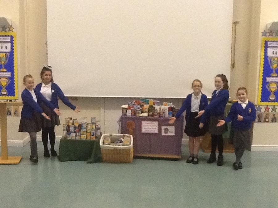 The mini-vinnies did a great job, reading in the Liturgy and helping collect all this food. Well done