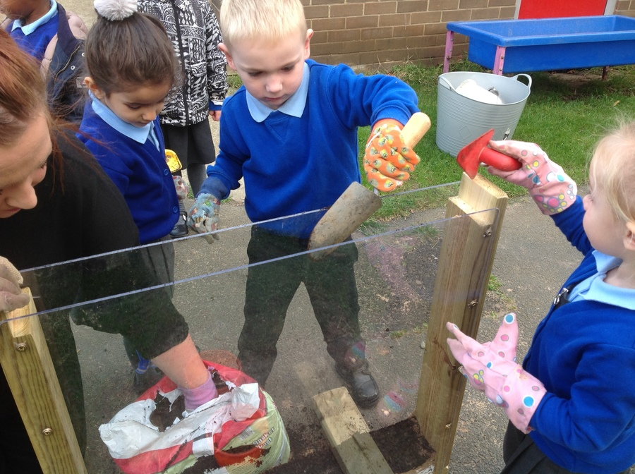 The nursery children had fun setting up the wormery. They will watch to see what happens.